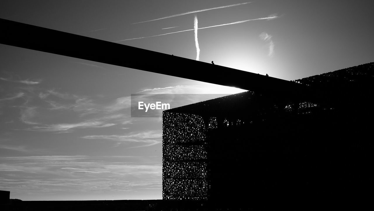 sky, low angle view, built structure, silhouette, no people, outdoors, architecture, building exterior, day, nature