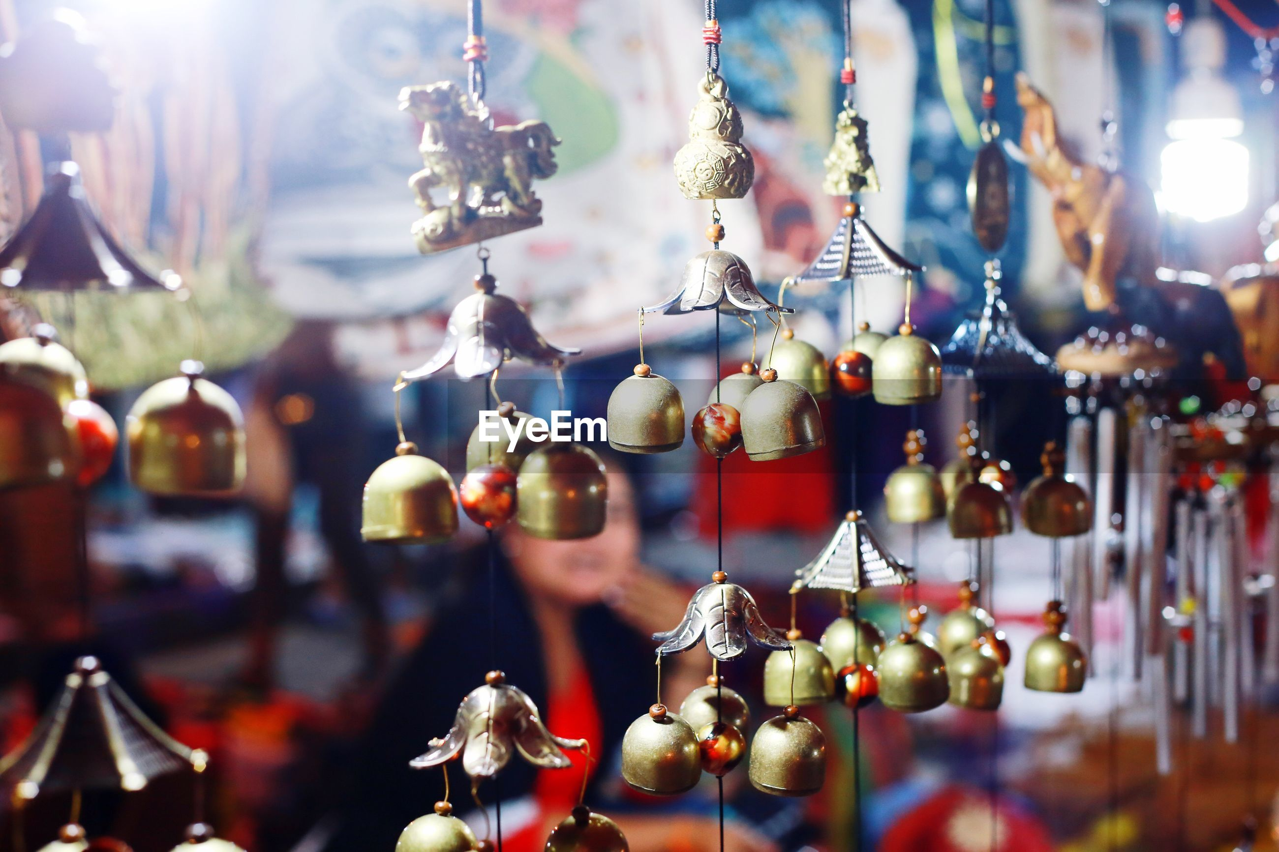 Close-up of wind chimes hanging for sale