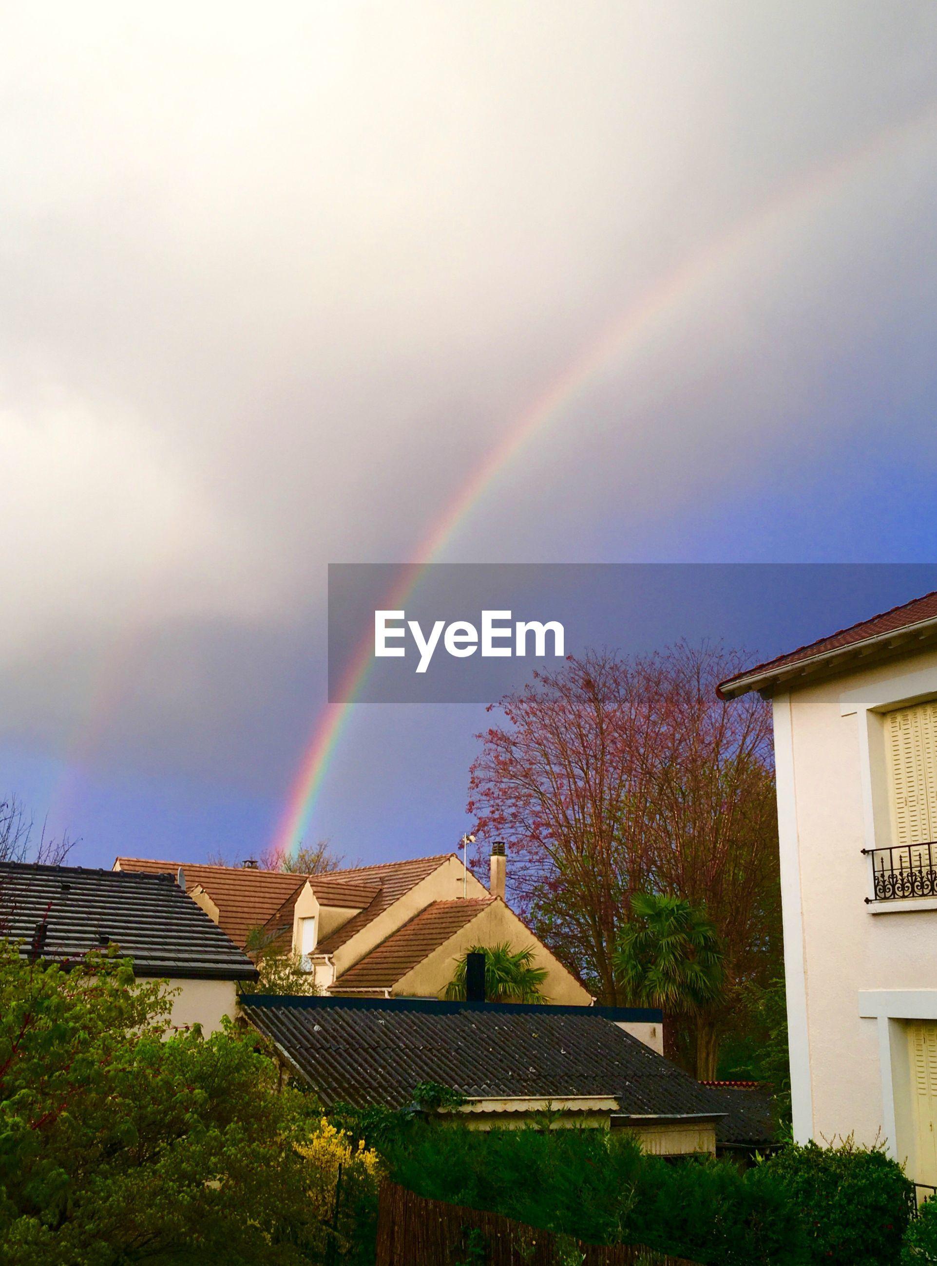Rainbow over houses