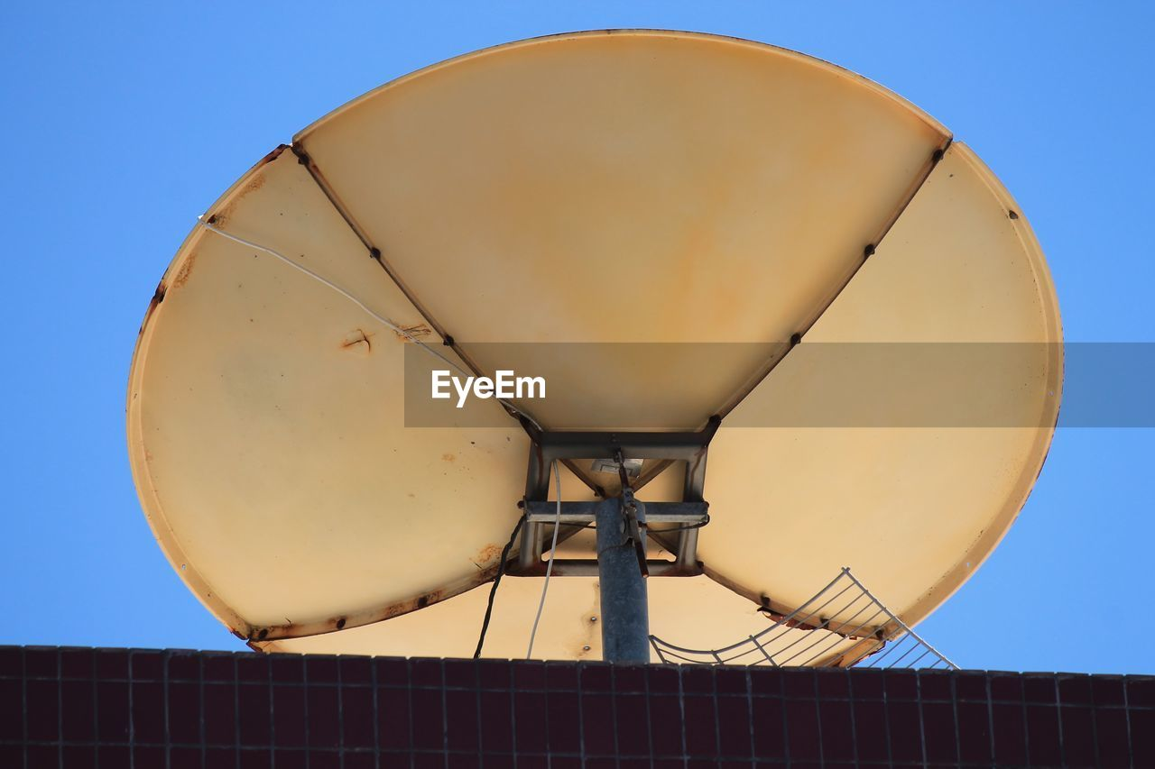 sky, architecture, low angle view, built structure, clear sky, no people, nature, building exterior, water tower - storage tank, outdoors, storage tank, geometric shape, day, metal, circle, shape, environmental conservation, satellite, satellite dish, blue, water conservation