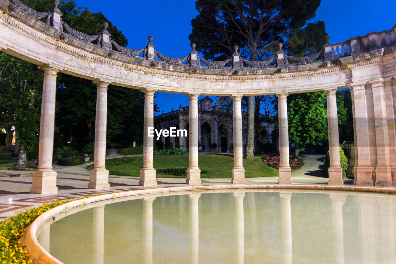 architecture, architectural column, built structure, reflection, plant, history, the past, water, tourism, travel destinations, tree, building exterior, nature, sky, travel, no people, day, ancient, lake, outdoors, archaeology, ancient civilization, courtyard, ruined