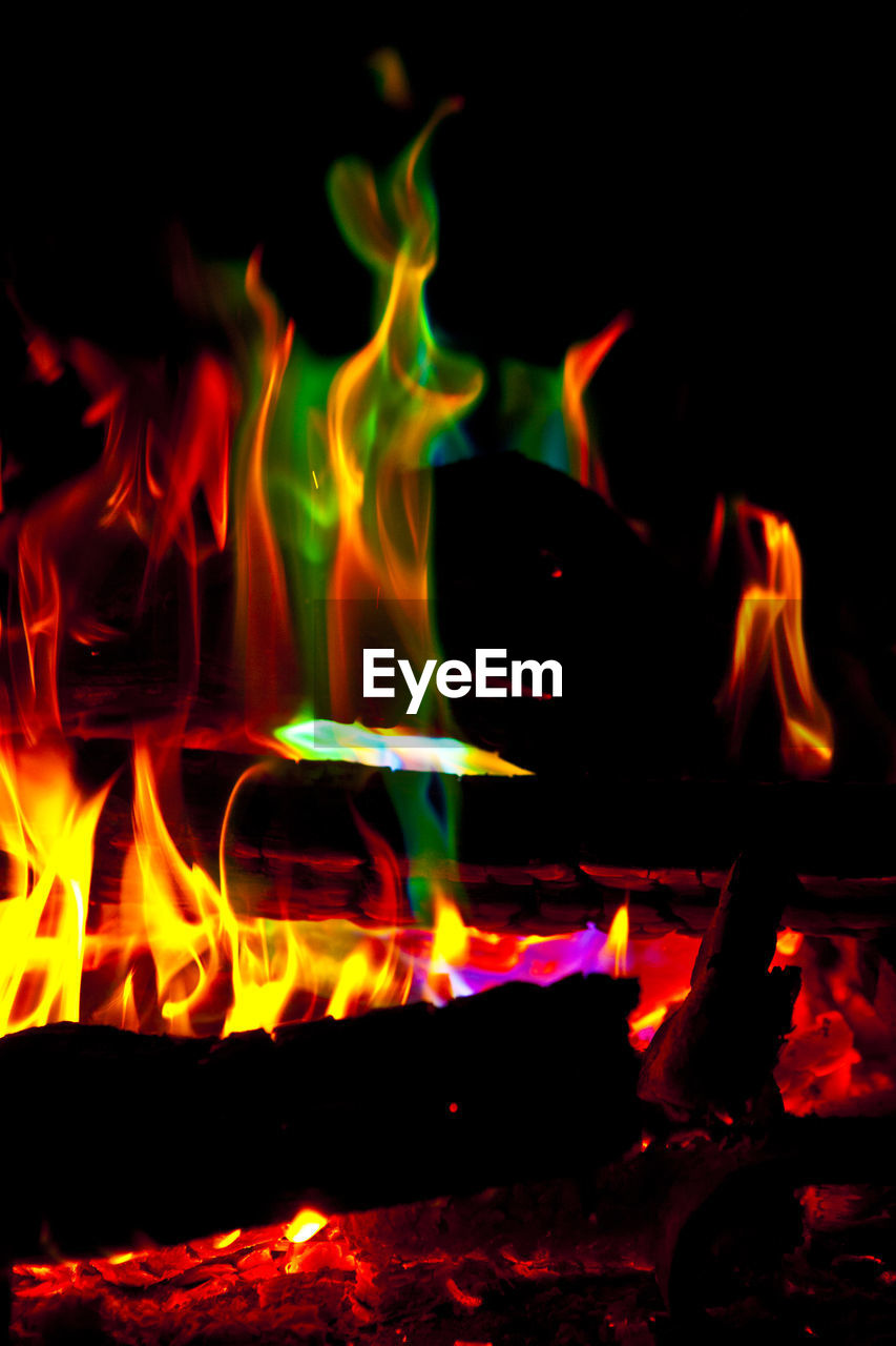 flame, fire, fire - natural phenomenon, heat - temperature, burning, motion, glowing, orange color, night, nature, close-up, no people, blurred motion, log, long exposure, bonfire, wood - material, wood, firewood, environment, campfire