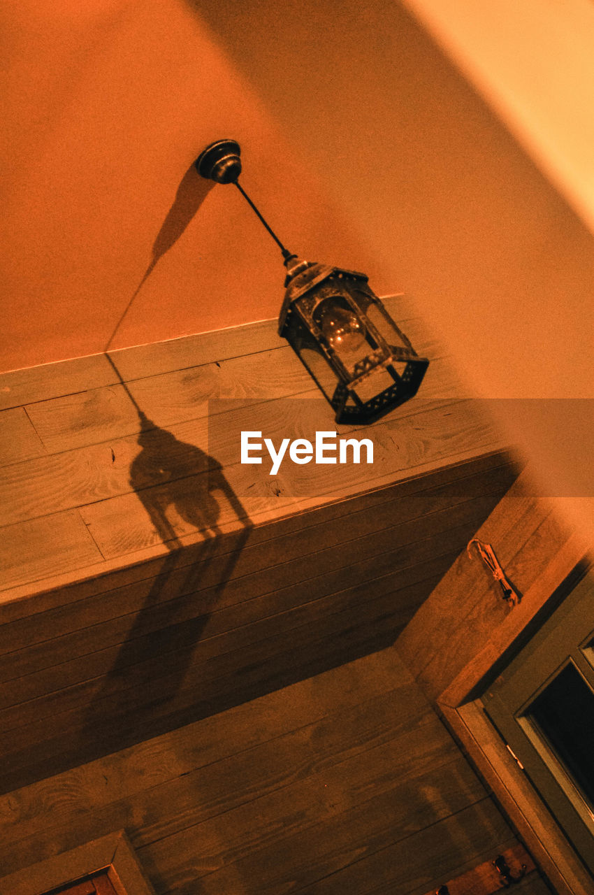 indoors, wood - material, high angle view, hardwood floor, no people, table, wood, flooring, still life, wall - building feature, home interior, lighting equipment, brown, architecture, built structure, technology, shadow, modern, arts culture and entertainment, electric lamp