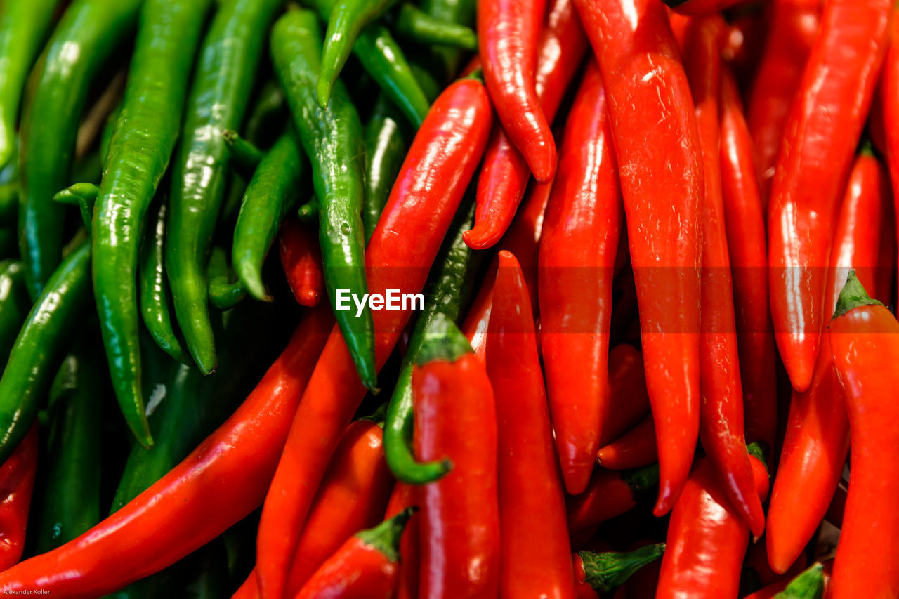 vegetable, red, pepper, chili pepper, spice, food and drink, food, backgrounds, full frame, red chili pepper, freshness, still life, large group of objects, no people, green color, close-up, abundance, market, healthy eating, wellbeing, sale