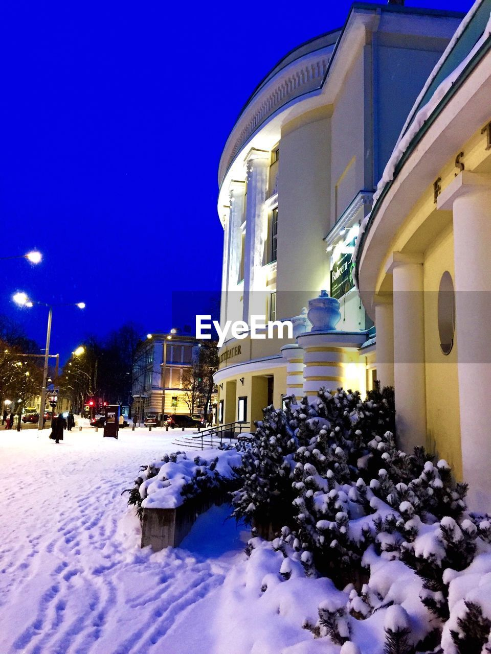 Snow Covered Street By Estonian National Opera During Dusk