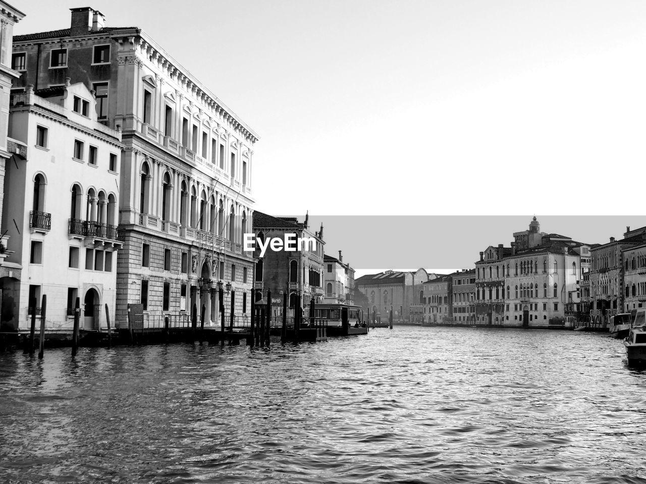 Grand canal amidst buildings against clear sky