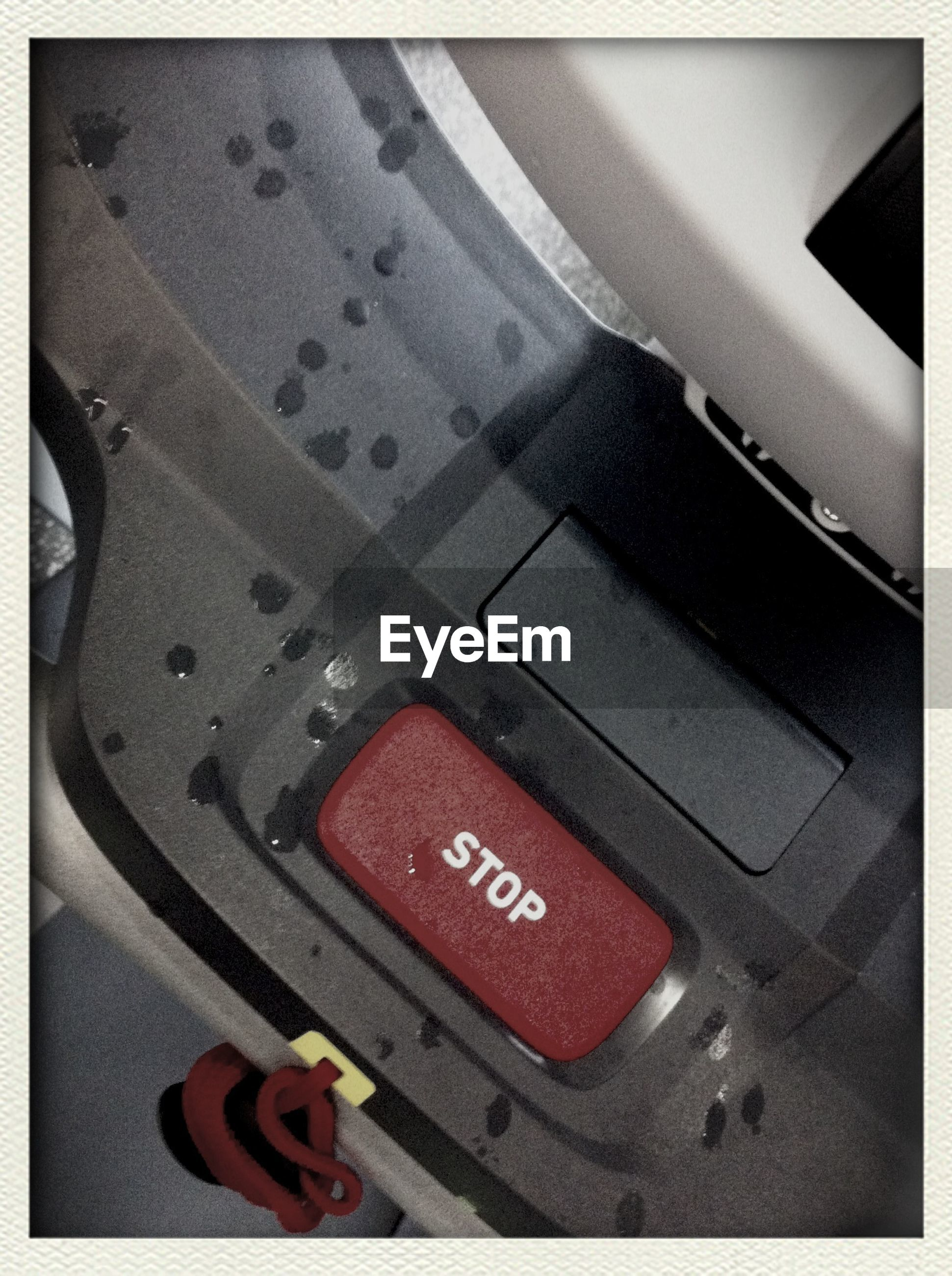 Stop button on control panel of machine