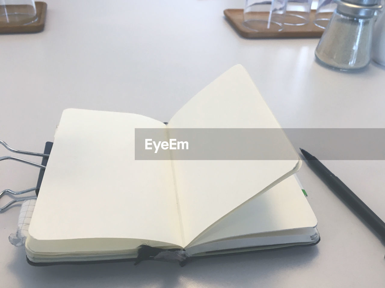 HIGH ANGLE VIEW OF OPEN BOOK