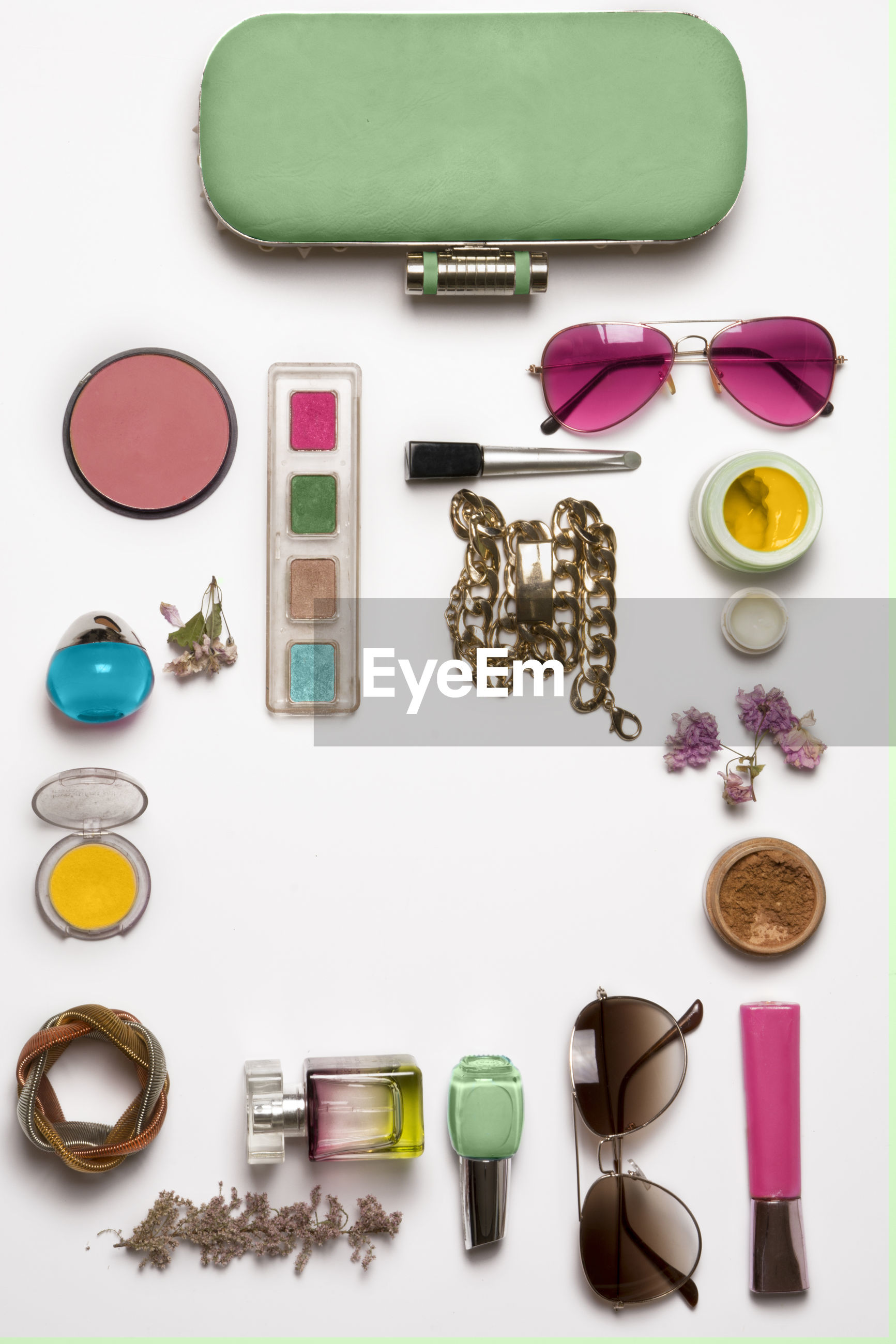 High angle view of various personal accessories on white background
