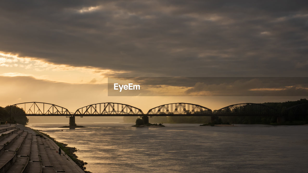 cloud - sky, water, sky, bridge, architecture, bridge - man made structure, built structure, connection, sunset, transportation, nature, arch, engineering, waterfront, beauty in nature, river, scenics - nature, orange color, outdoors, arch bridge