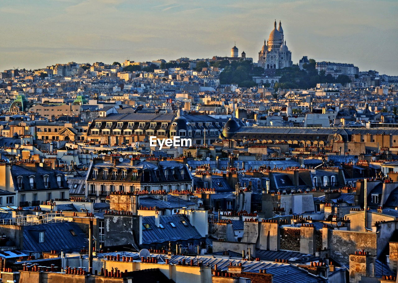 Distant View Of Basilique Du Sacre Coeur With Cityscape In Foreground