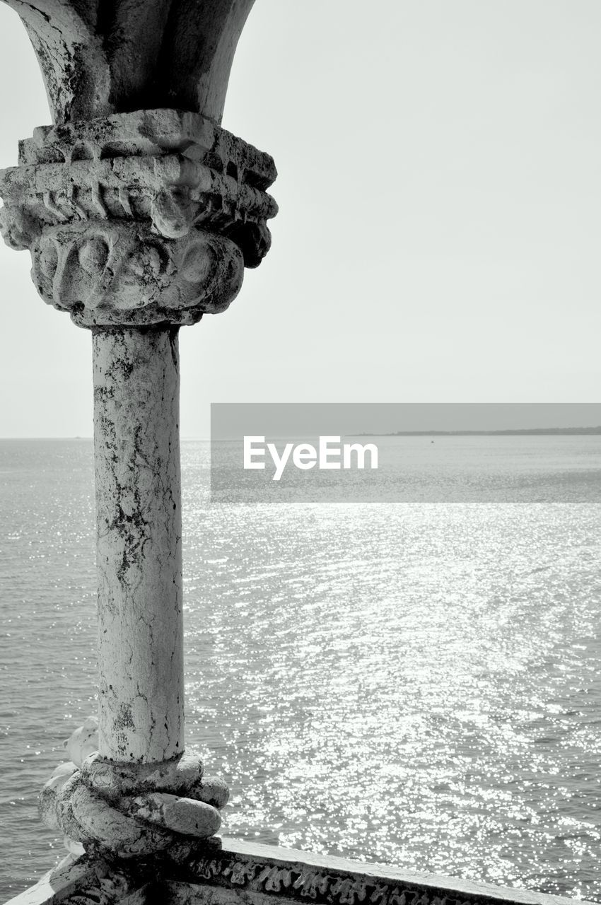 water, sky, sea, horizon, horizon over water, beauty in nature, no people, nature, scenics - nature, clear sky, day, tranquility, tranquil scene, outdoors, idyllic, non-urban scene, copy space, land, tree, wooden post