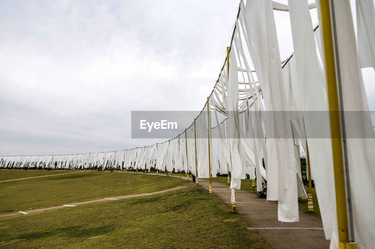 White fabrics hanging in park against clear sky
