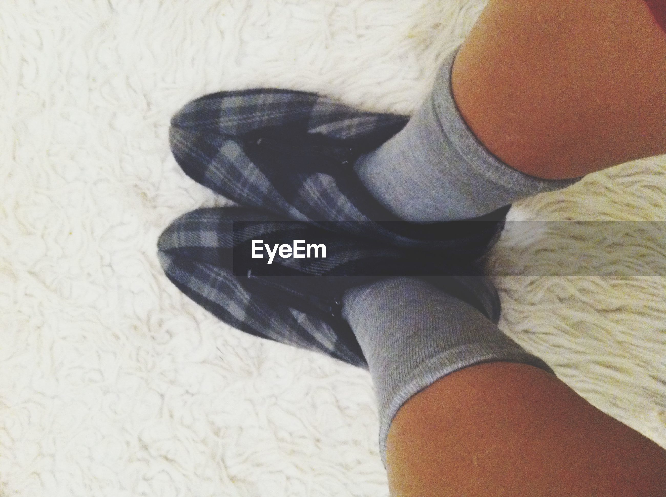 low section, person, lifestyles, personal perspective, leisure activity, part of, men, standing, shoe, human foot, casual clothing, jeans, unrecognizable person, indoors, close-up