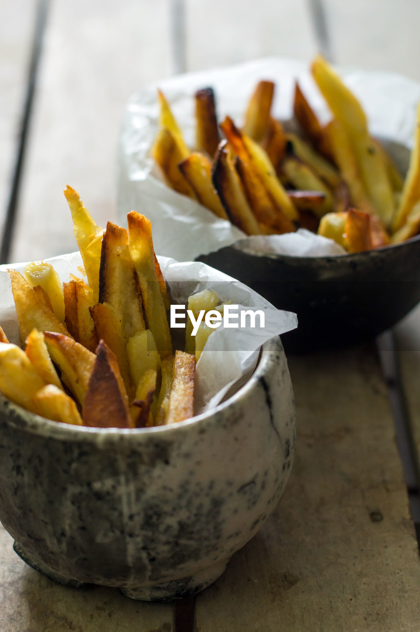 Close-up of french fries in bowls on table