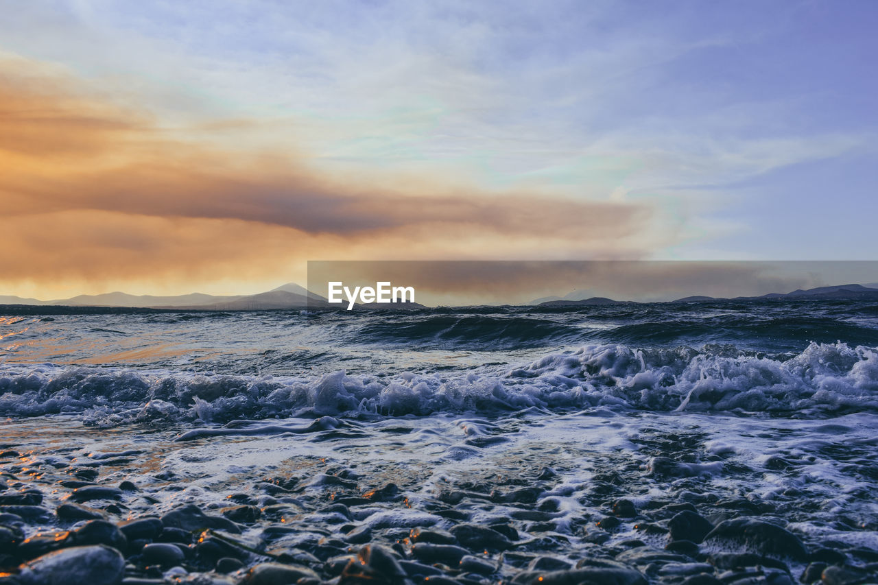 sea, cloud - sky, sky, beauty in nature, water, motion, scenics - nature, sunset, wave, nature, sport, land, beach, no people, aquatic sport, outdoors, tranquility, idyllic, power in nature