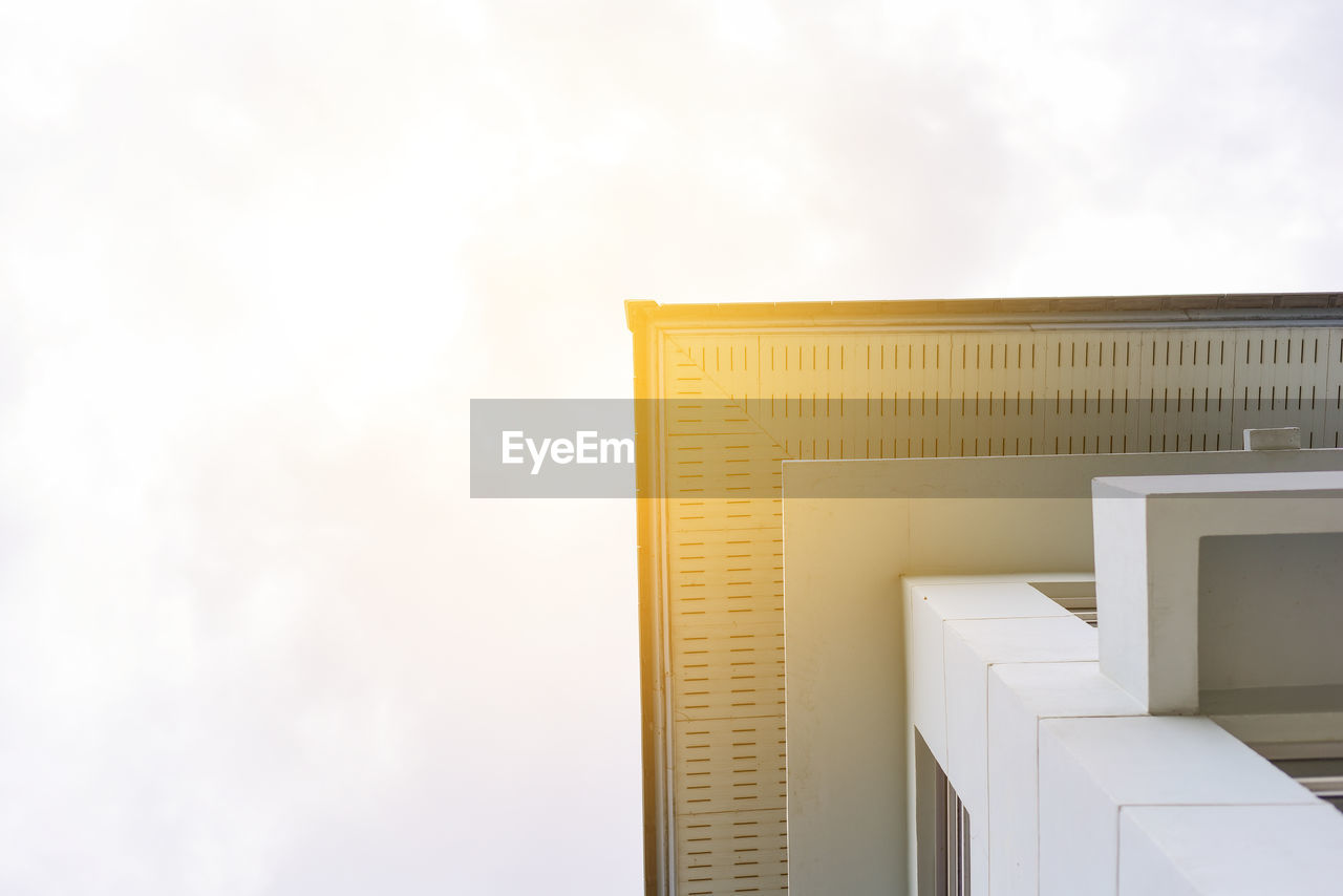 architecture, built structure, sky, building exterior, building, no people, low angle view, cloud - sky, nature, day, wall - building feature, outdoors, yellow, copy space, modern, white color, staircase, gold colored, tower, window