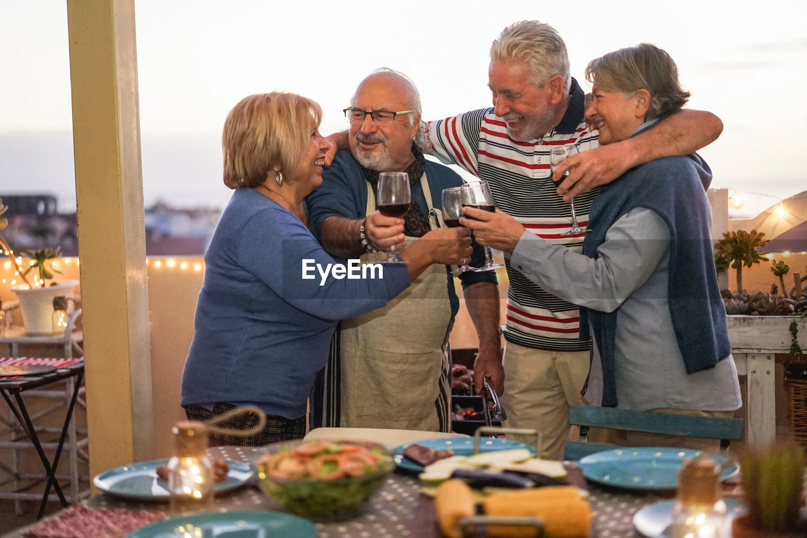 People having drink at table in balcony
