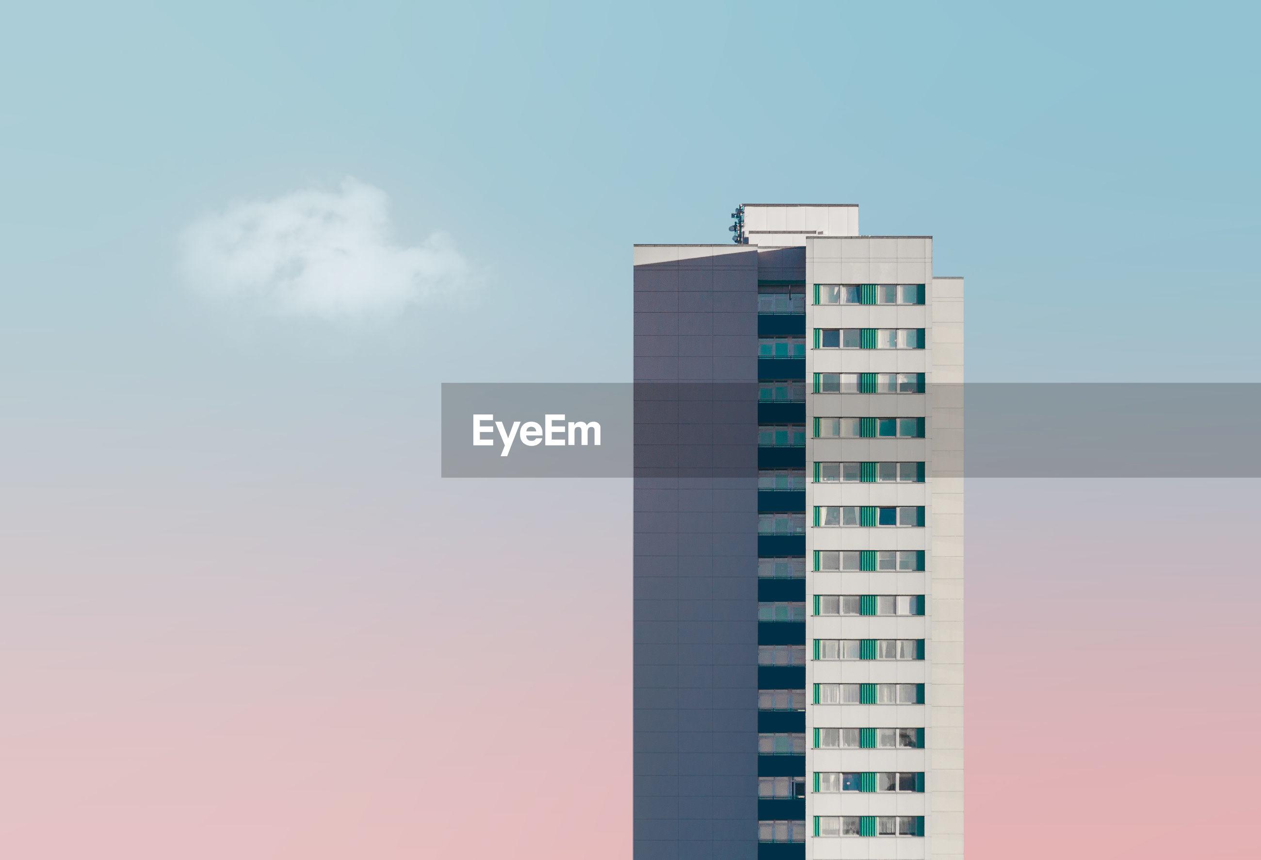 Skyscraper against sky during sunset