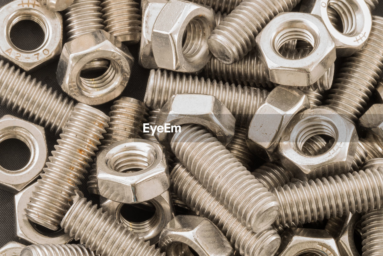 High Angle View Of Nuts And Bolts On Table