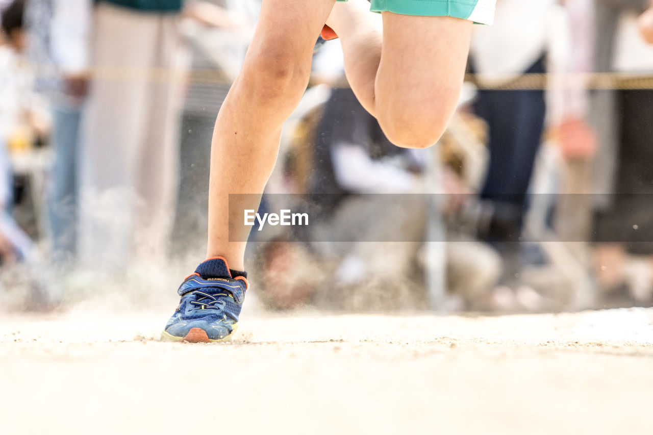 Low Section Of Man Running On Track