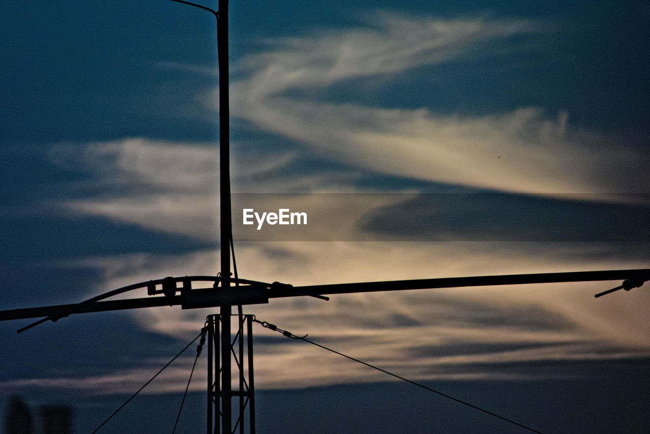 sky, cloud - sky, connection, no people, low angle view, cable, fuel and power generation, silhouette, outdoors, day, sunset, technology, nature, close-up, industrial windmill