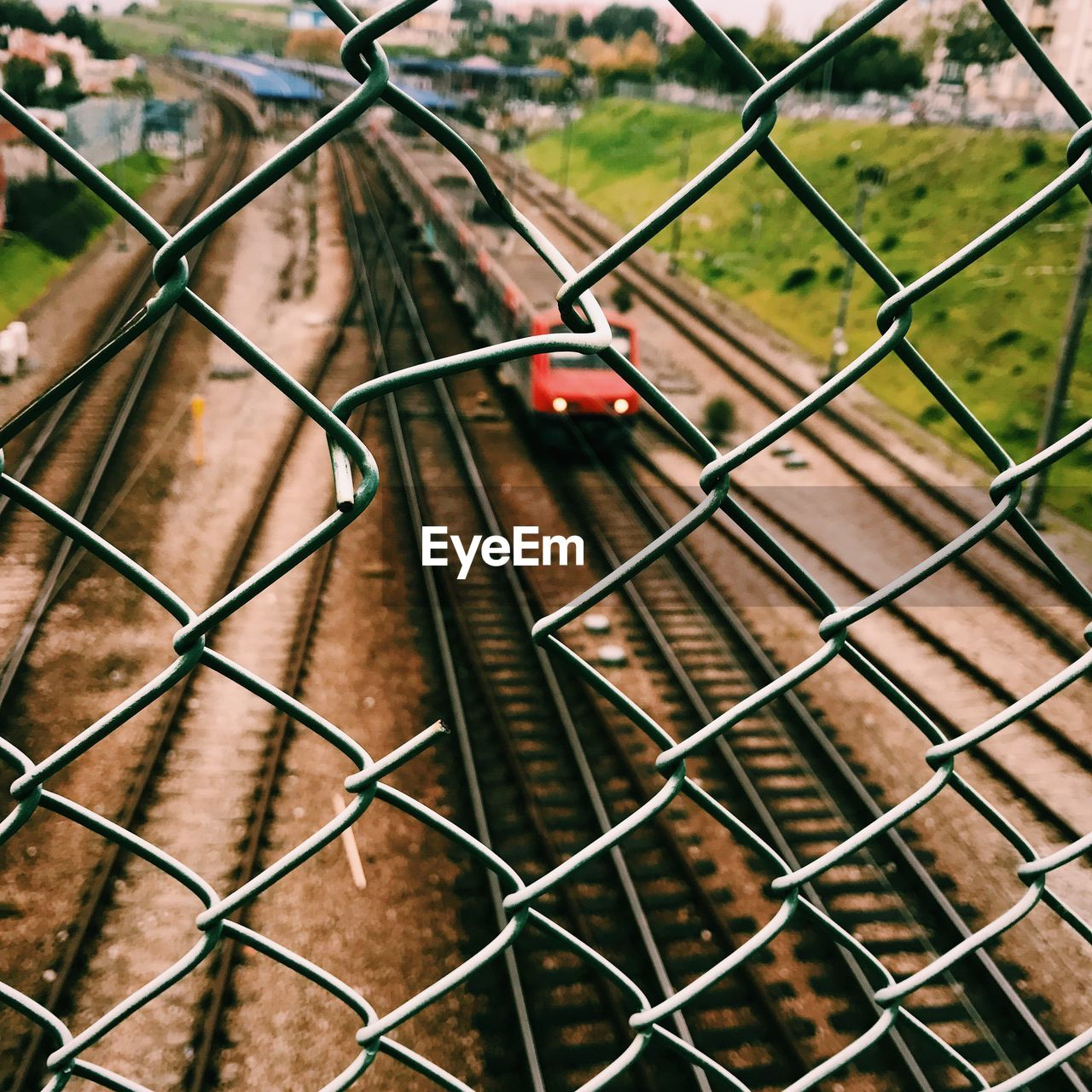fence, boundary, barrier, chainlink fence, protection, safety, security, metal, no people, transportation, day, pattern, high angle view, mode of transportation, track, nature, focus on foreground, rail transportation, railroad track, land vehicle, outdoors, crisscross