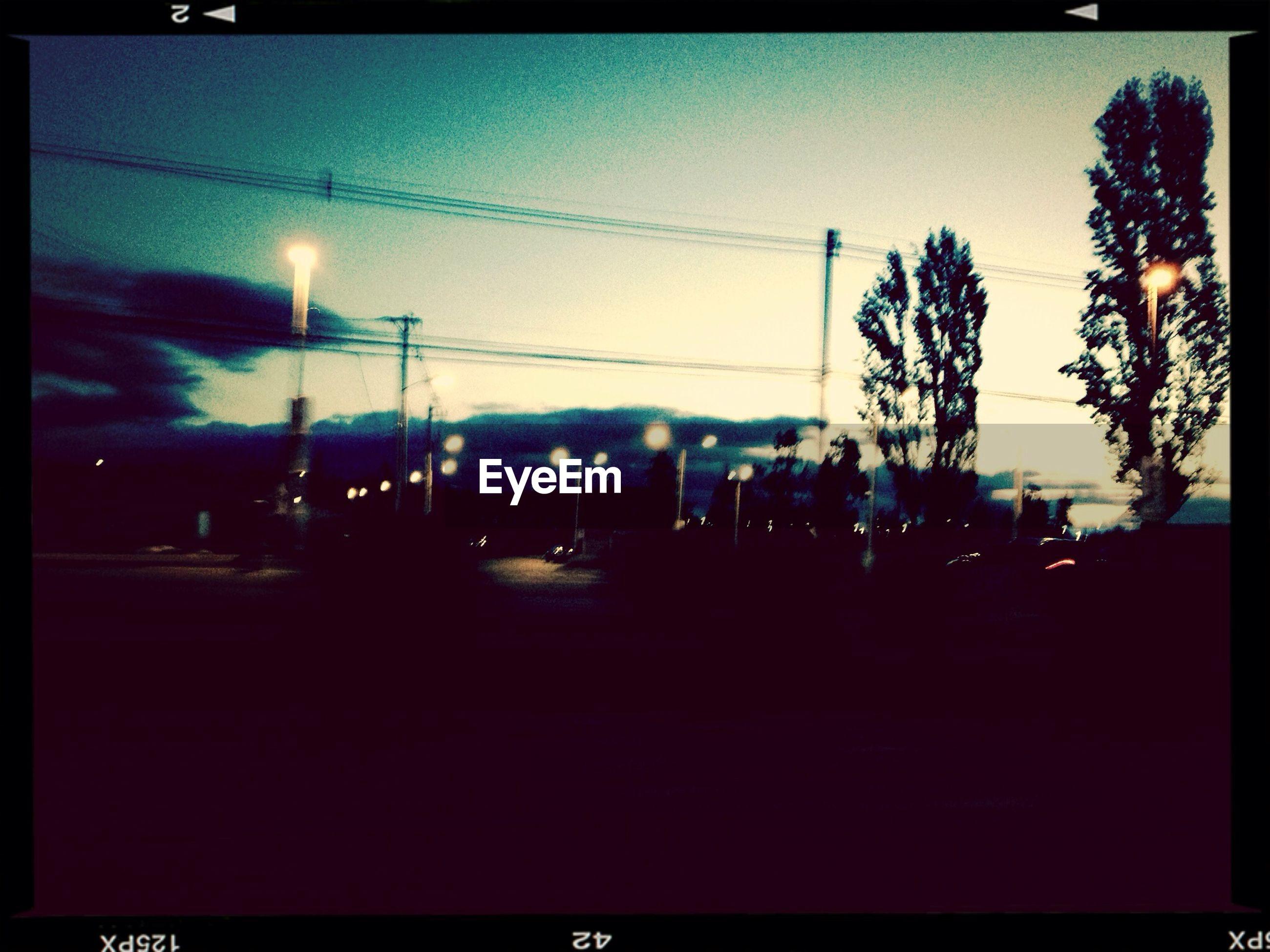 VIEW OF ILLUMINATED STREET LIGHTS