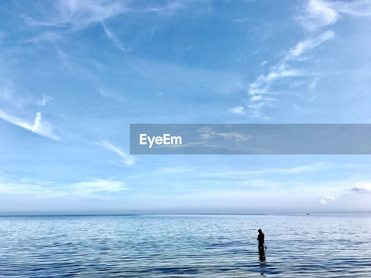 sky, sea, water, cloud - sky, horizon over water, beauty in nature, horizon, tranquility, scenics - nature, one person, tranquil scene, waterfront, nature, day, leisure activity, lifestyles, real people, non-urban scene, outdoors