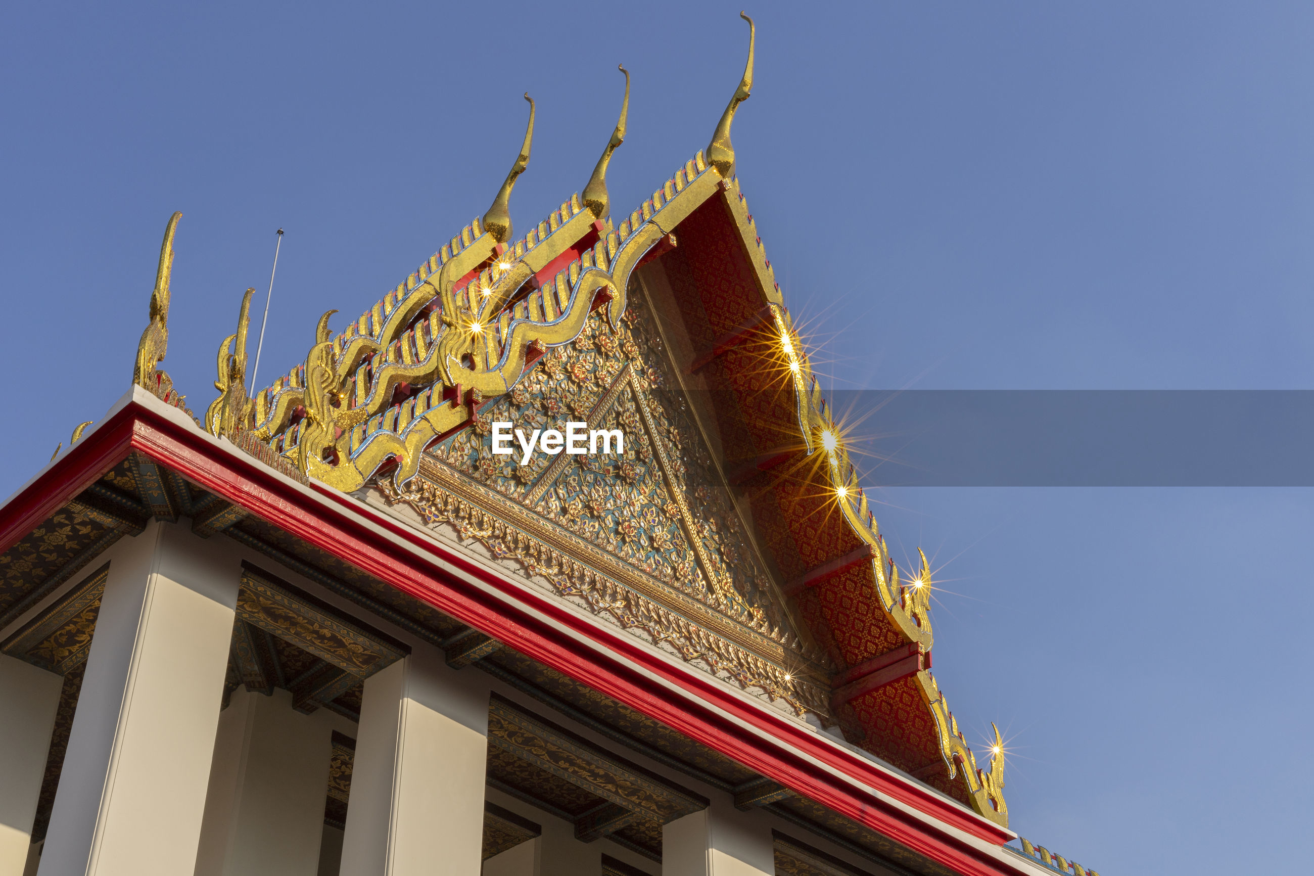 LOW ANGLE VIEW OF TEMPLE AGAINST BUILDING