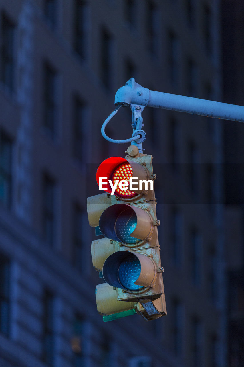 focus on foreground, hanging, building exterior, no people, architecture, built structure, day, low angle view, close-up, outdoors, metal, safety, communication, multi colored, lighting equipment, decoration, blue, protection, light, stoplight