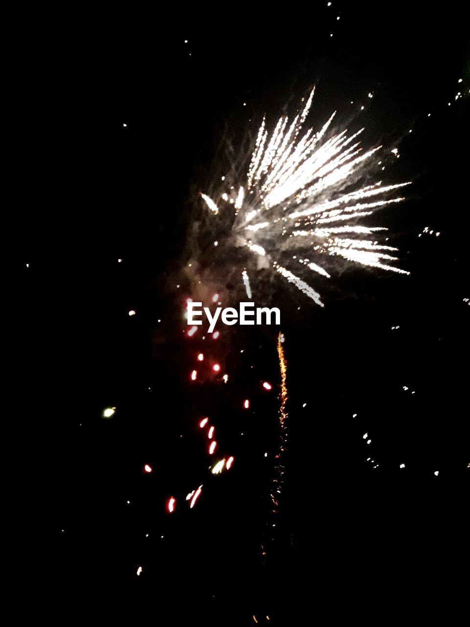 firework display, celebration, night, firework - man made object, exploding, event, arts culture and entertainment, long exposure, firework, glowing, low angle view, outdoors, illuminated, motion, no people, sky, multi colored, diwali