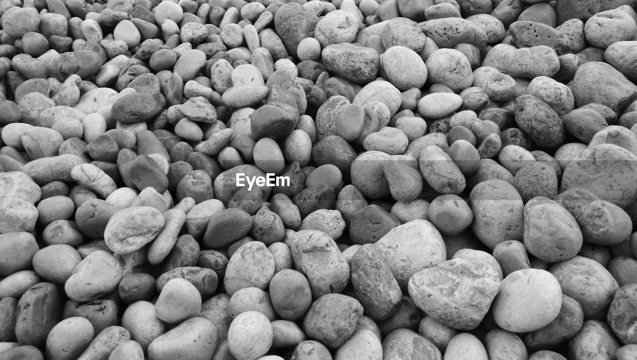 full frame, backgrounds, large group of objects, abundance, no people, nature, food, healthy eating, food and drink, freshness, indoors, pebble, rock, high angle view, gray, solid, stone, agriculture, day, water, temptation