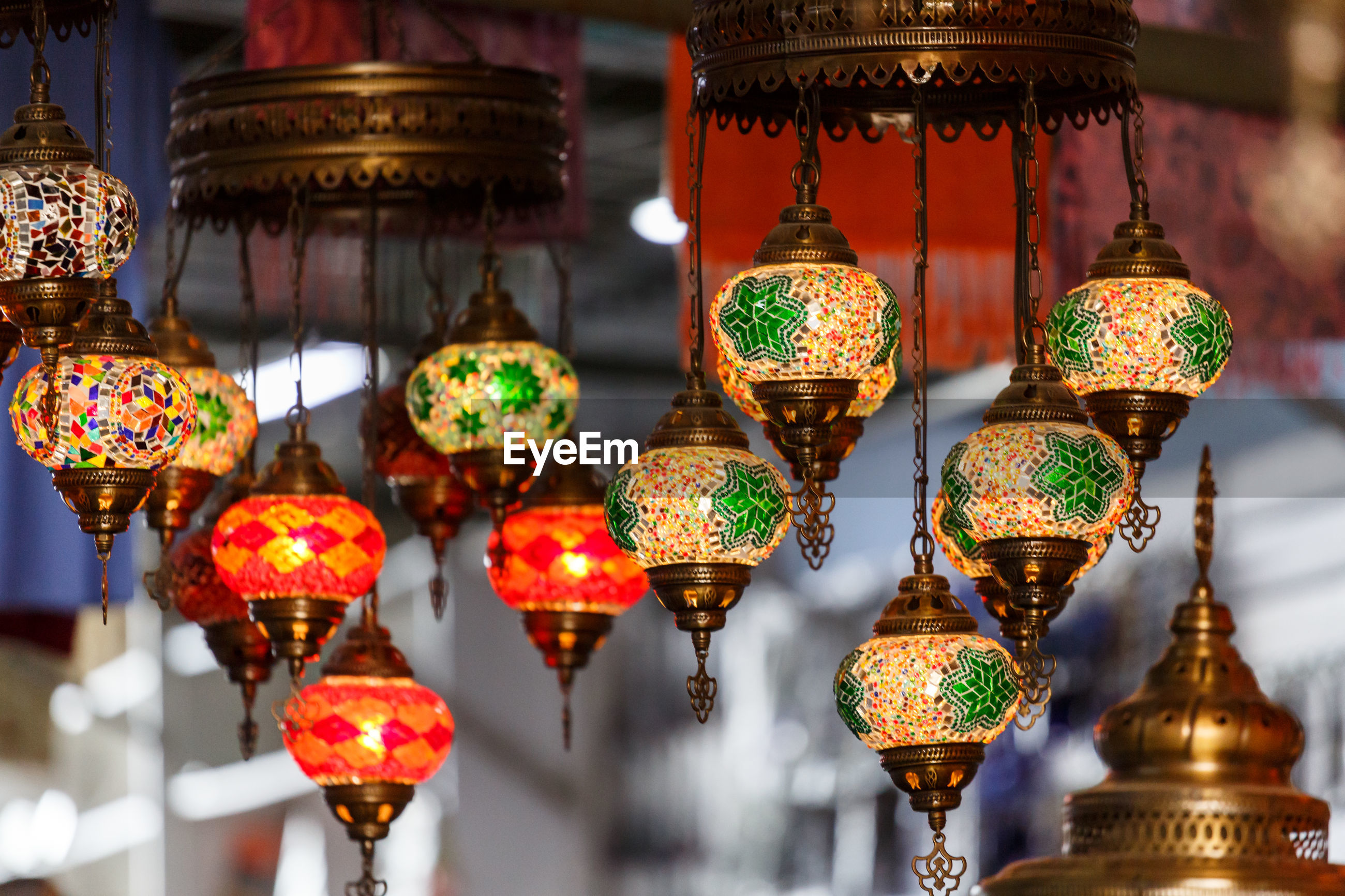 Illuminated lanterns hanging in row