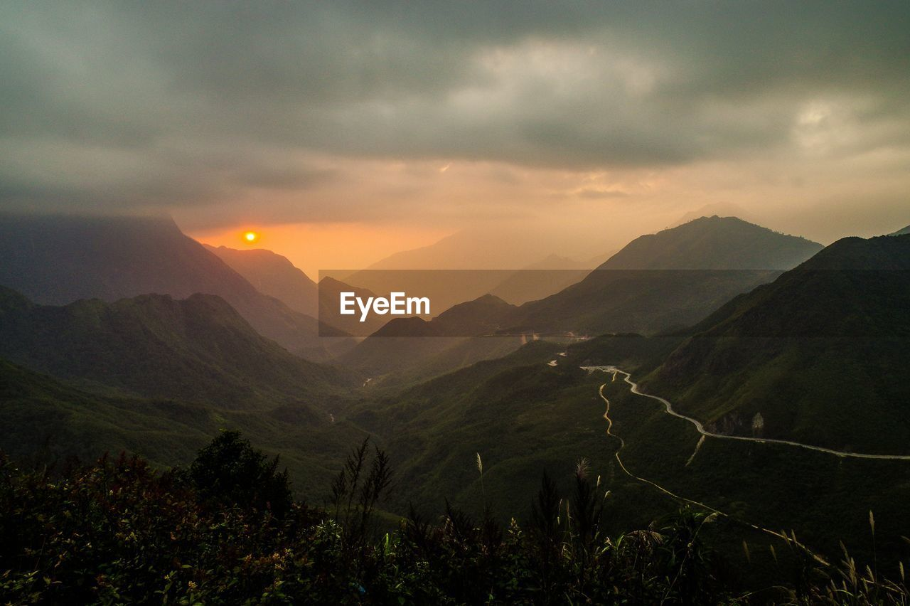 High Angle View Of Grassy Mountains During Sunset
