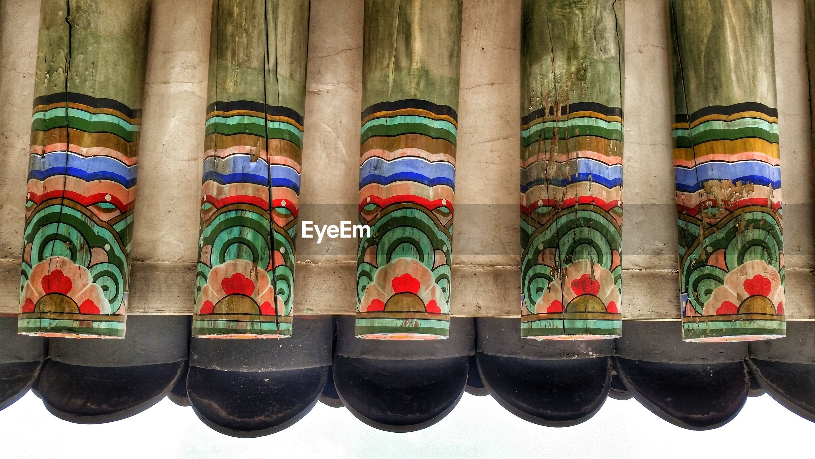 Upside down image of painted wooden poles