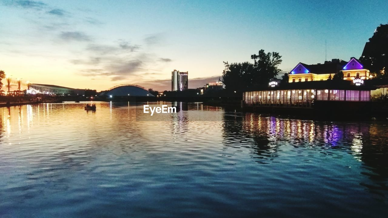 water, built structure, architecture, reflection, building exterior, sunset, sky, waterfront, outdoors, nature, silhouette, lake, tranquility, scenics, no people, tree, beauty in nature, day