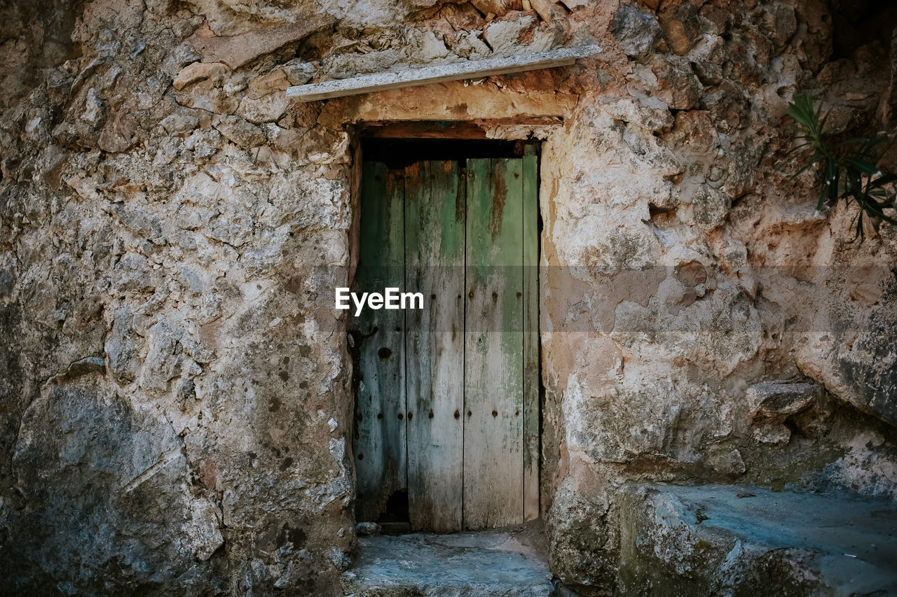 CLOSED DOORS OF HISTORIC BUILDING