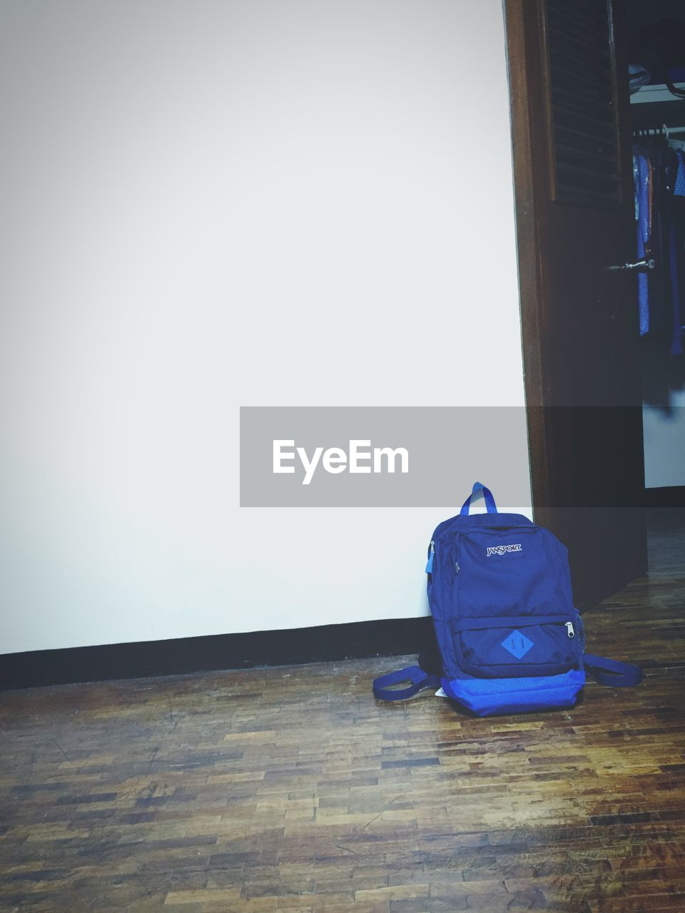 backpack, indoors, hardwood floor, table, no people, day, luggage, blue, close-up