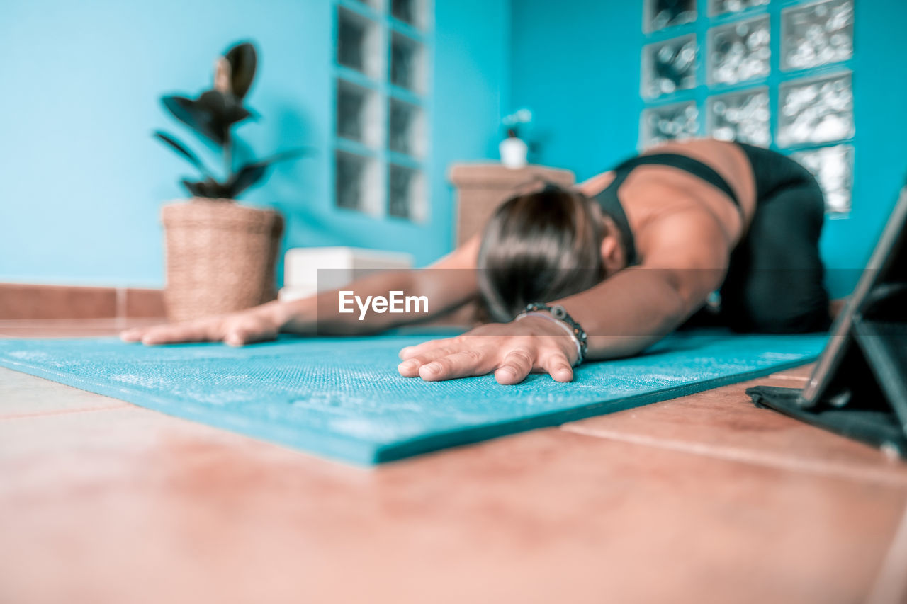 Surface level of woman exercising at home