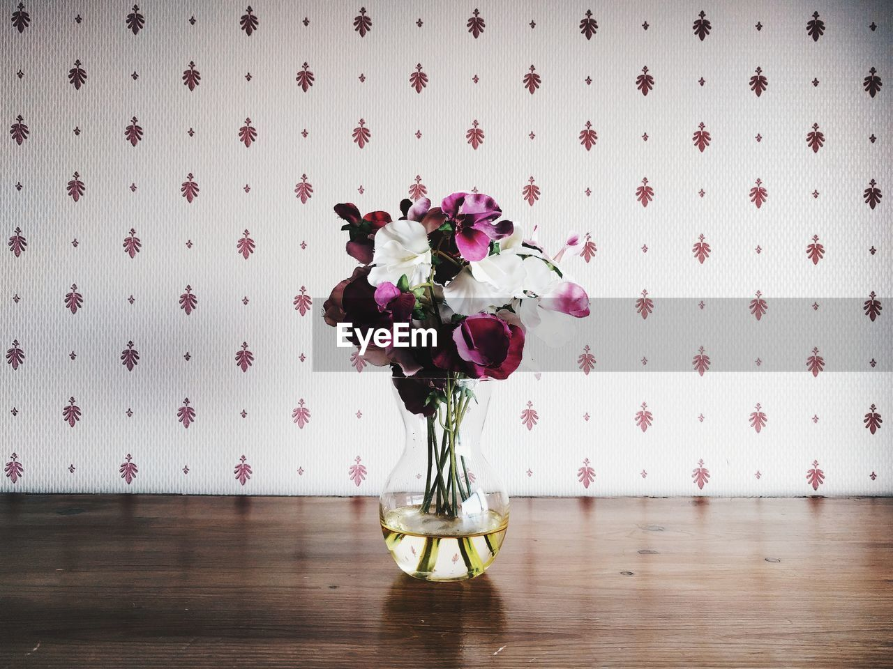 Close-up of flower bouquet in vase on table