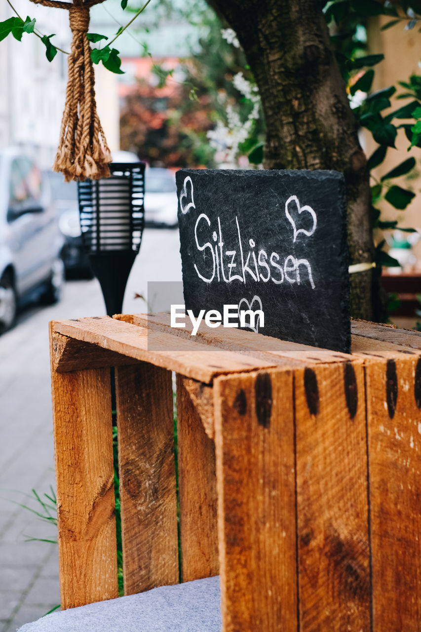 Text on wooden planks outdoors