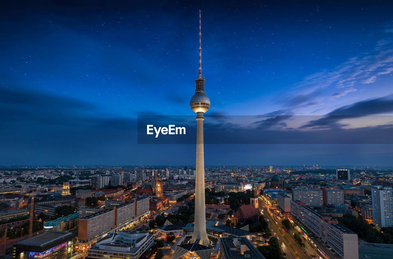 Fernsehturm Amidst Illuminated City At Night