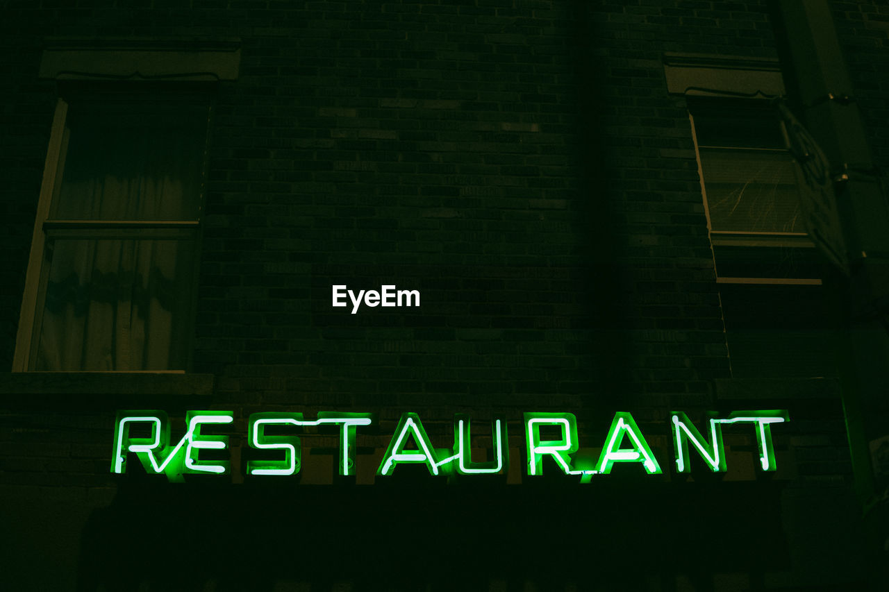 LOW ANGLE VIEW OF ILLUMINATED SIGN ON BUILDING