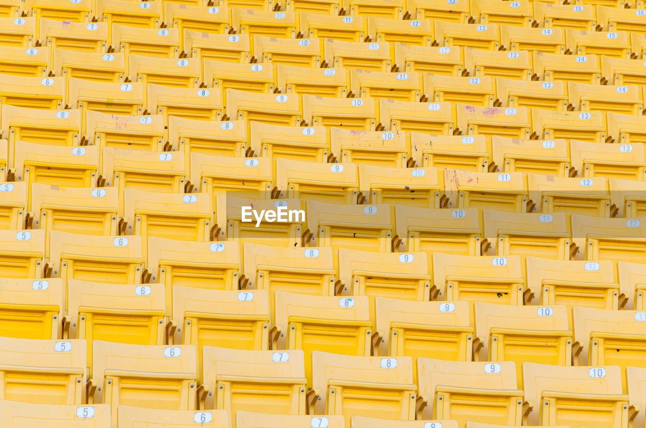 Full frame shot of yellow seats