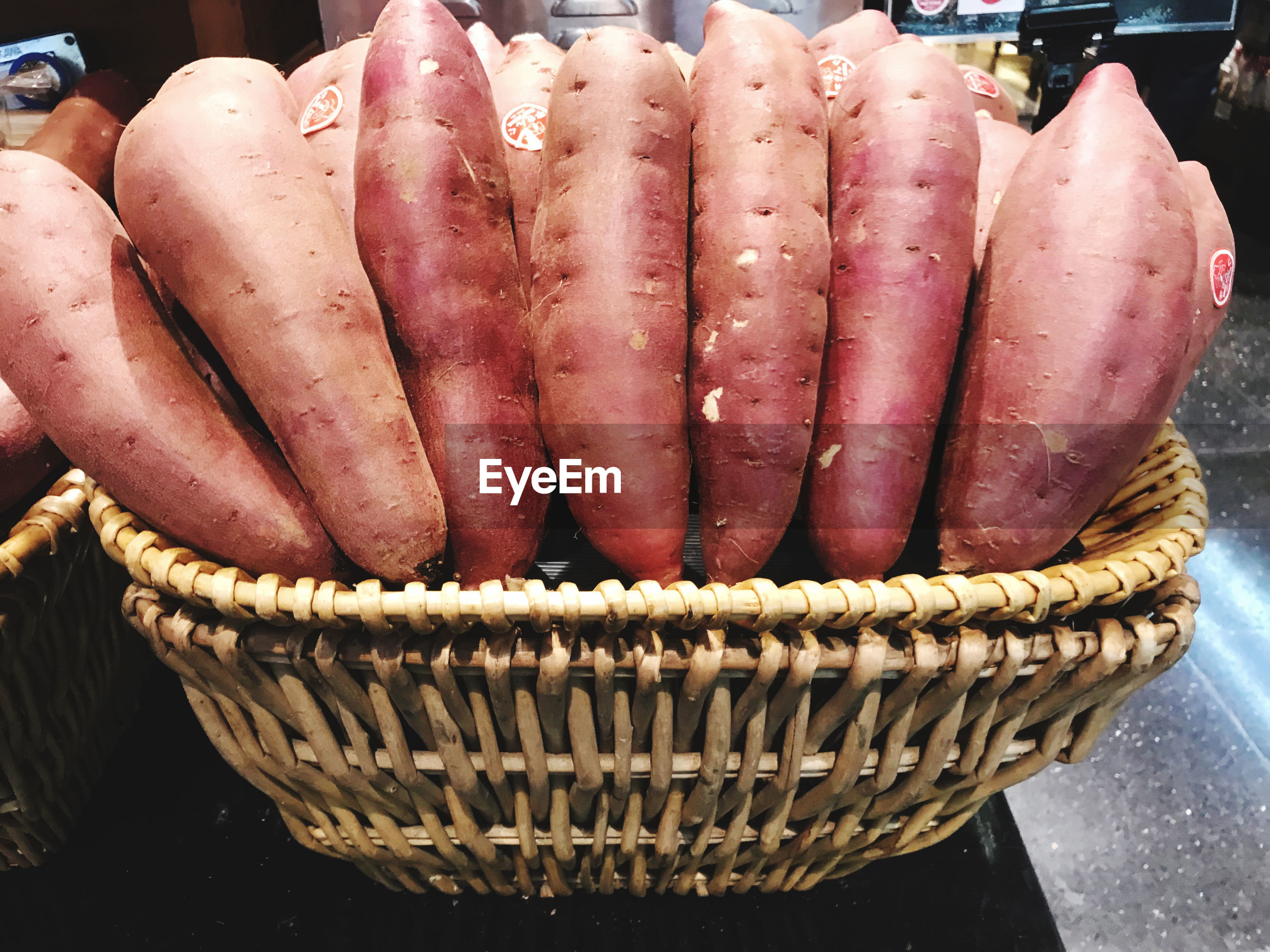 CLOSE-UP OF CARROTS IN BASKET