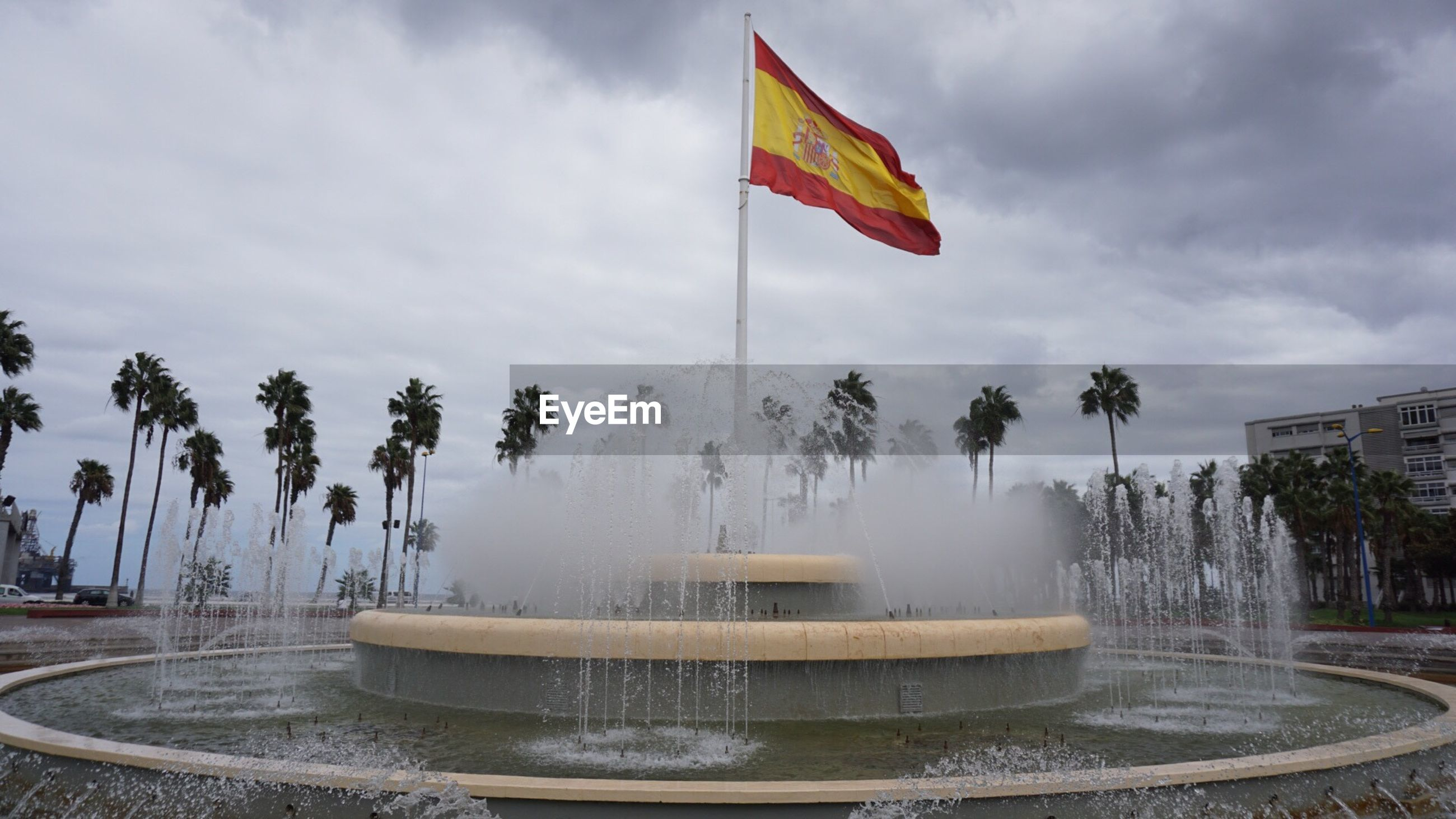 Fountain with spanish flag and palmtrees