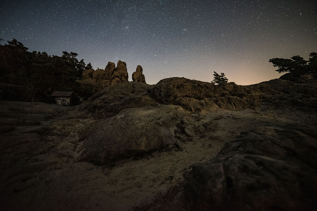 sky, night, star - space, scenics - nature, astronomy, tranquil scene, space, star, tranquility, beauty in nature, nature, star field, galaxy, rock, no people, plant, rock - object, non-urban scene, tree, rock formation, outdoors, space and astronomy