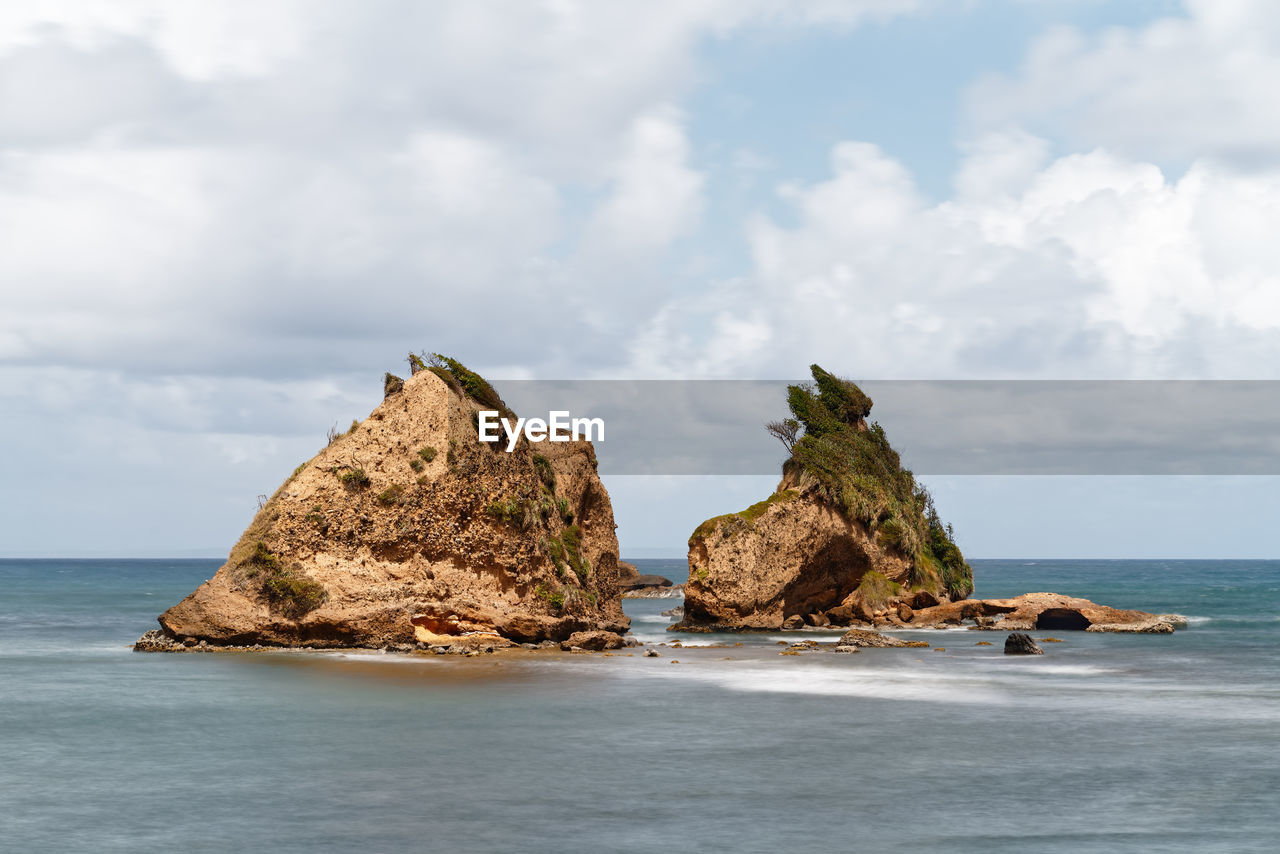 PANORAMIC VIEW OF ROCKS ON SEA AGAINST SKY