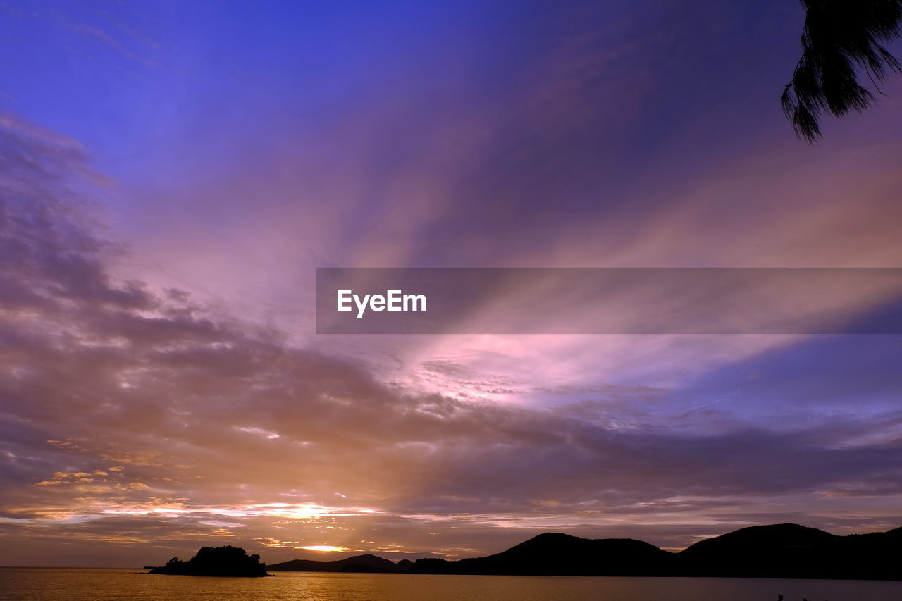 sky, sunset, cloud - sky, beauty in nature, scenics - nature, silhouette, tranquil scene, tranquility, orange color, no people, nature, idyllic, outdoors, non-urban scene, dramatic sky, low angle view, environment, dusk, landscape, mountain, purple, romantic sky